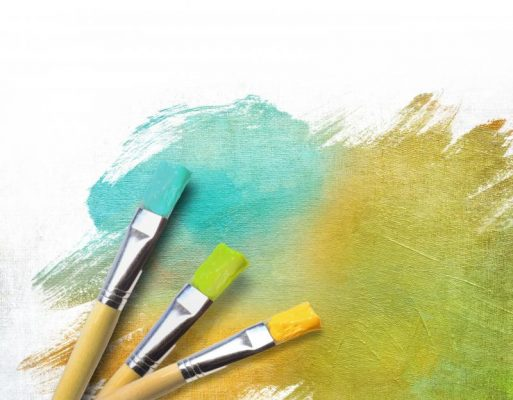 artist-brushes-with-a-half-finished-painted-color-canvas